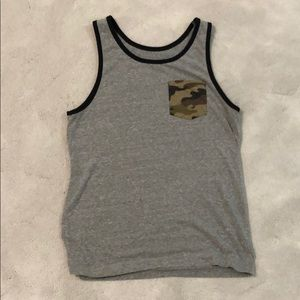 Fitted tank top with camo pocket.